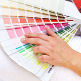 Color chart and woman hand. Color chart with woman hand choosing pink shades stock images