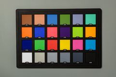The color checker passport on a gray background. Close-up view from above. stock image