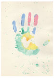 Color child hand print. Watercolor color child hand print on a colored background Royalty Free Stock Photography