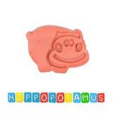 Color children's hippopotamus plasticine. On a white background stock images