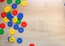 Color children`s meccano on a light wooden background royalty free stock photos