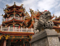 Color Chinese temple with lion stone Stock Images