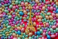 Color Chocolate Easter eggs and Golden Eiffel tower souvenir royalty free stock images