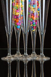 Color chocolate smarties inside the champagne glasses Stock Photo