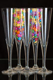 Color chocolate tablets inside the champagne glasses Royalty Free Stock Photos