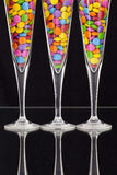 Color chocolate tablets inside the champagne glasses Stock Photo