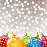Color Christmas balls on shiny background Stock Image