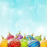 Color Christmas balls on sky background Royalty Free Stock Images