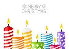 Color Christmas candles on white Royalty Free Stock Photography