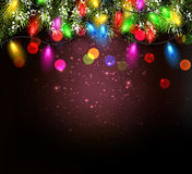 Color Christmas garland on vinous background. Royalty Free Stock Photos