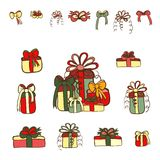 Color Christmas gifts set with bow set. Christmas gifts and bows vector set. Color doodles on white background Royalty Free Stock Photography