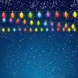 Color Christmas light bulbs on sky Stock Images