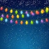 Color Christmas light bulbs on sky Royalty Free Stock Image