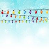 Color Christmas light bulbs on sky background Stock Photos