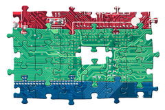 Color circuit board puzzle isolated on white Royalty Free Stock Photo