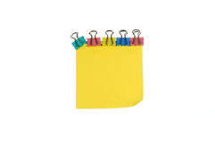 Color clip and yellow sticky notes. White background color clips and yellow sticky notes Stock Photos