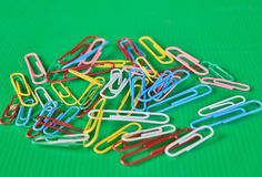 Color clips on green background Royalty Free Stock Photo