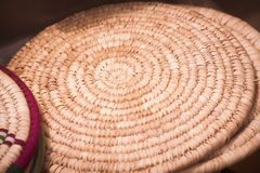 Spiral straw cushion detail. Color close up of a spiral straw cushion Stock Image