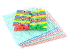 Color clothes-pegs and color napkins Stock Images