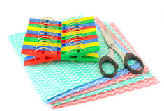 Color clothes-pegs, scissors and napkins Stock Photos