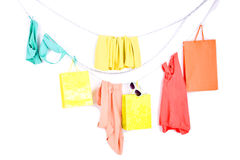Color clothes and shopping bags on white Royalty Free Stock Photos