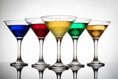 Color cocktails in martini glasses Royalty Free Stock Image
