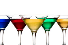 Color cocktails in martini glasses Royalty Free Stock Images