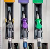 Colour coded petrol pump nozzles. Color coded petrol pump nozzles Royalty Free Stock Images