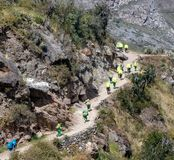 Views of Porters Along the Inca Trail Bound for Machu Picchu. Color Coded Porters along the Inca Trail bound for Machu Picchu, Peru royalty free stock image