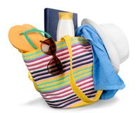 Vacations Concept, Colorful Bag with beach items. Color colorful bag summer beach close up suntan lotion stock images