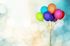 Bunch of colorful balloons on blue background Stock Photos