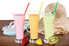 Colorful healthy milkshakes, strawberry, mango stock image