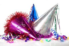 Colorful party hats on white background stock photography