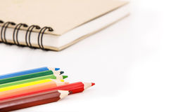 Color. Ing pencil  and notebook on white background Royalty Free Stock Photography