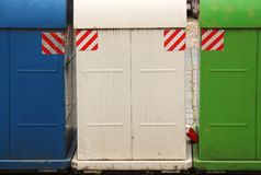 Three colored garbage container on the street of Prague stock photography
