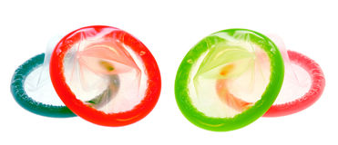 Color Condoms. Isolated on white Stock Photo