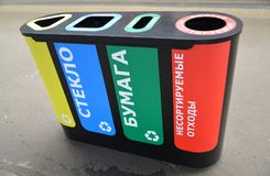 Color container for separate collecting garbage. The Russian tex - plastic, glass, paper, not sorted waste. Color container for separate collecting garbage. The royalty free stock image