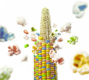 Color corncob explodes and produces popcorn Royalty Free Stock Photos