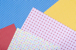 Color craft paper with diffrent designs. stock images