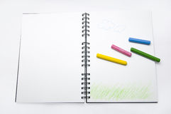 The color crayon. And notebook Stock Photos