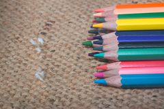 The color Crayon. Isolated on Sackcloth background Royalty Free Stock Photography