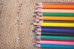 The color Crayon. Isolated on Sackcloth background Stock Photography