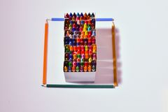 Color crayons and pencils in a square. Color crayons display Royalty Free Stock Photography