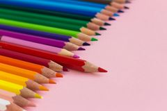 Color crayons in order one taller above. On pink background nobody Stock Photos