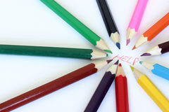 COLOR CRAYONS SURROUNDING HELP WORD Stock Photo