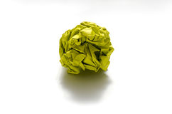 Color crumpled paper ball on a white. Yellow color crumpled paper ball on a white background Stock Image