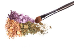 Color crushed eye shadow and brush. stock photos