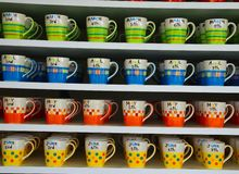 Color Cup. Coffee colour cup lays on the shelf stock image