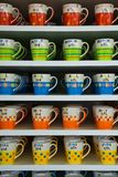 Color Cup. Coffee colour cup lays on the shelf royalty free stock image