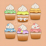 Color cupcakes. Set of color cupcakes with whipped cream Royalty Free Stock Images